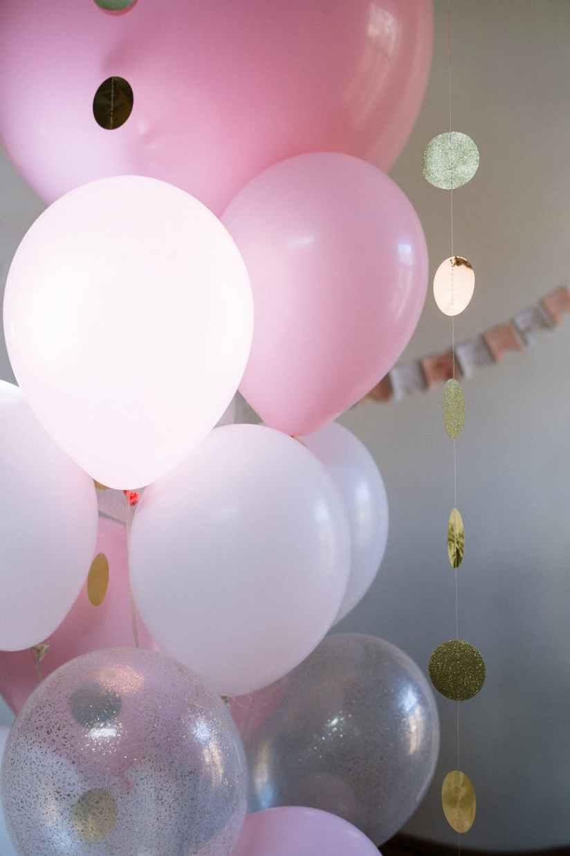 pink and white balloons on ceiling